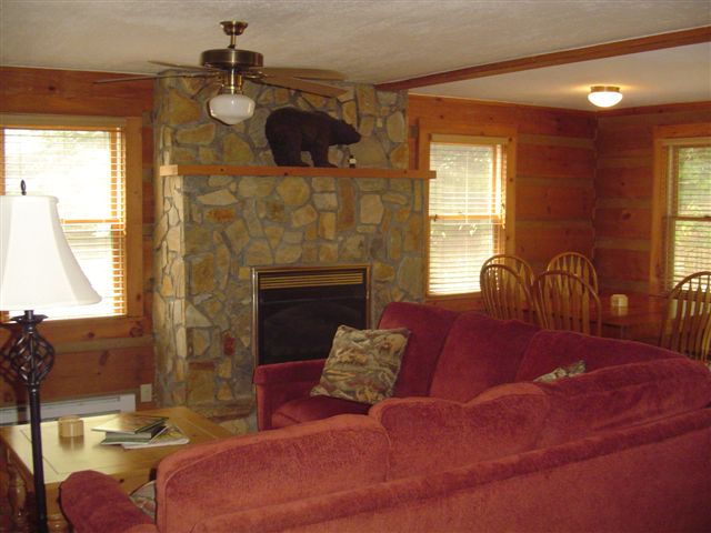 This Blowing Rock Cabin features a spacious den with stone fireplace.