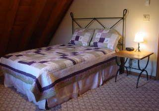 Queen bed in upstairs bedroom of blowing rock cabin
