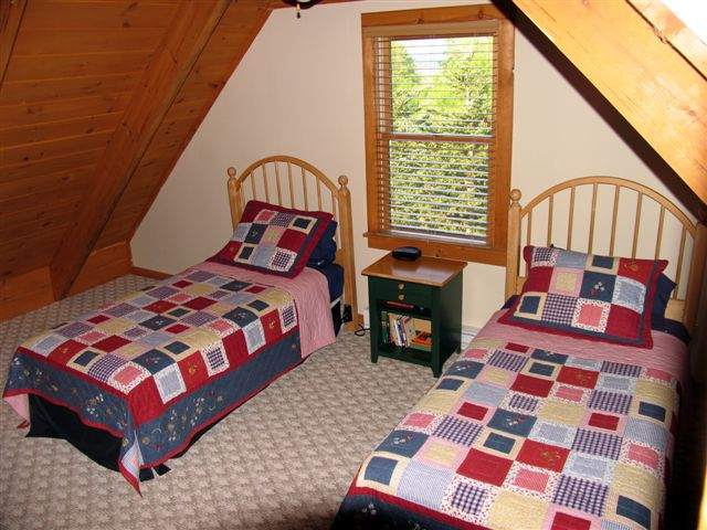 Two twin beds in second upstairs bedroom
